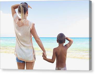 Mother And Son At Beach Canvas Print by Kicka Witte