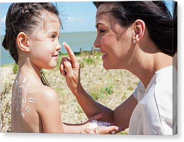 Mother Applying Suncream To Daughter Canvas Print
