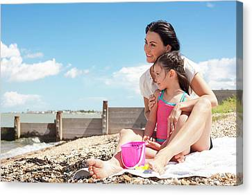 Bonding Canvas Print - Mother Daughter On Beach by Ian Hooton