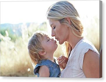 Mother Kissing Daughter Canvas Print