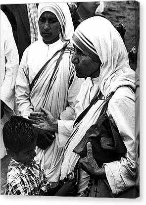 Mother Teresa With Young Boy Canvas Print by Retro Images Archive
