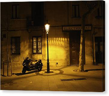 Motorcycle By Lamplight In Barcelona Canvas Print by Madeline Ellis