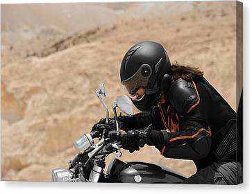 Motorcyclist In A Desert Canvas Print