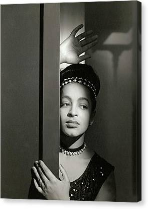 Moune Posing By A Wall Canvas Print by Horst P. Horst