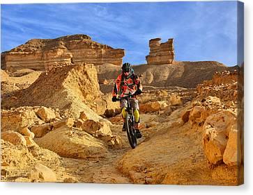 Mountain Biker In A Desert Canvas Print
