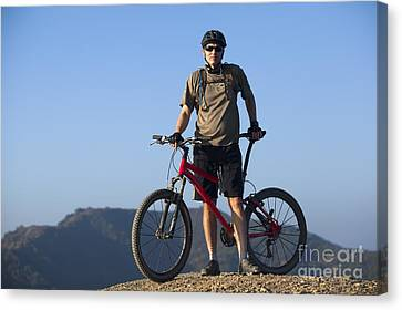 Mountain Biker Canvas Print by Mike Raabe