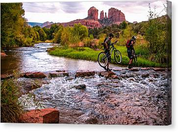 Mountain Bikers Crossing Cathedral Falls Canvas Print by Linda Pulvermacher