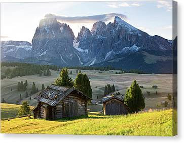 Mountain Cabins, Seiser Alm Sassolungo Canvas Print by Peter Adams