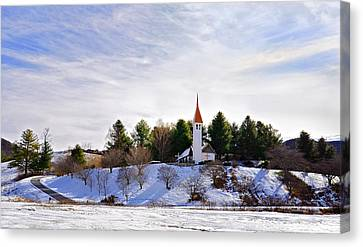 Mountain Church In Winter Canvas Print by Susan Leggett