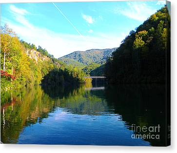 Mountain Lake Reflections Canvas Print by Lorraine Heath