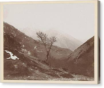 Mountain Landscape With Bare Tree And Some Snow Canvas Print by Artokoloro