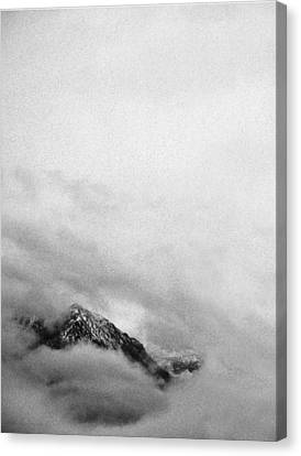 Mountain Peak In Clouds Canvas Print by Peter v Quenter