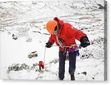 Mountain Rescue Team Member Abseiling Canvas Print by Ashley Cooper