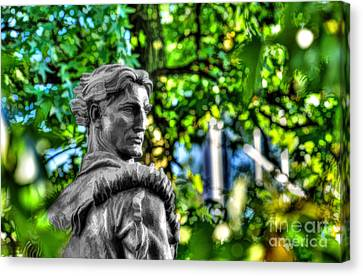 Mountaineer Statue In Trees Canvas Print by Dan Friend