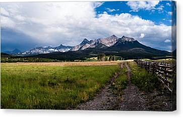 Canvas Print featuring the photograph Mountains And Fence by Jay Stockhaus