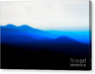 Mountains In The Mist Canvas Print by Carlee Ojeda