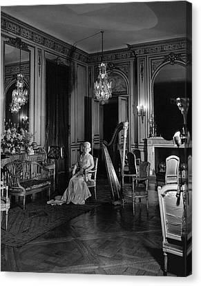 Mrs. Cornelius Sitting In A Lavish Music Room Canvas Print by Cecil Beaton