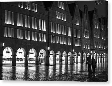 Cobblestone Night Walk In The Town Canvas Print by Miguel Winterpacht