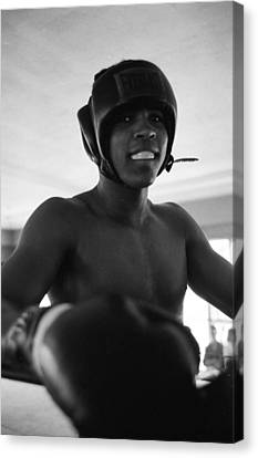 Muhammad Ali Looks Into Camera Canvas Print by Retro Images Archive