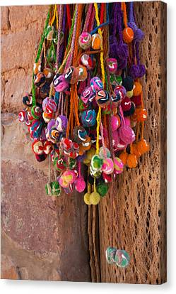 Multi-colored Hangings On Wall, Tulmas Canvas Print by Panoramic Images