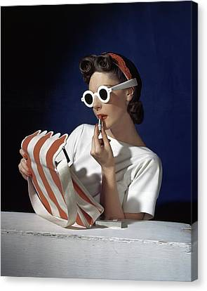 Muriel Maxel Applying Lipstick Canvas Print by Horst P. Horst