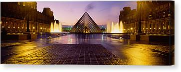 Museum Lit Up At Night With Ghosted Canvas Print by Panoramic Images
