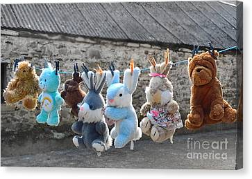Toys On Washing Line Canvas Print by Nina Ficur Feenan