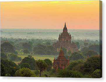 Myanmar Bagan Smoke From Cooking Fires Canvas Print by Inger Hogstrom