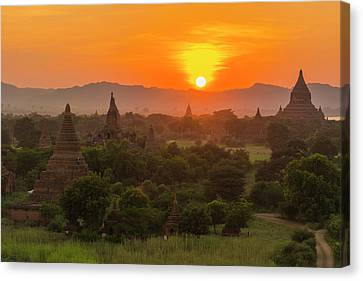 Myanmar Bagan Sunset Over The Temples Canvas Print by Inger Hogstrom