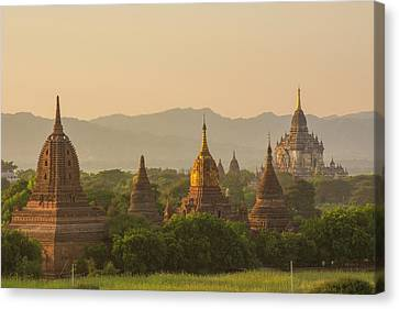 Myanmar Bagan Temples At Sunset Canvas Print by Inger Hogstrom