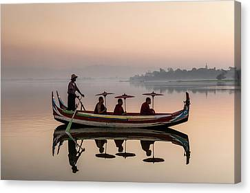 Myanmar, Monks In Boat At Ubein Bridge Canvas Print by Martin Puddy