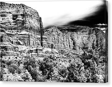 Mystical Rocks Canvas Print by John Rizzuto
