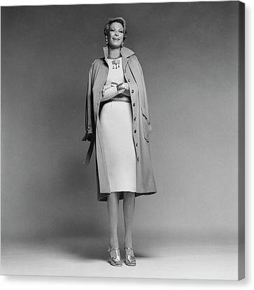 Nan Kempner Wearing A Coat And Dress Canvas Print