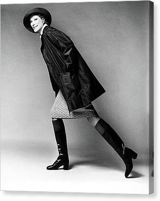 Nan Kempner Wearing A Raincoat And Hat Canvas Print