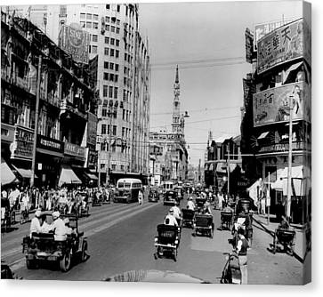 Nanking Road In Shanghai 1949 Canvas Print by Retro Images Archive