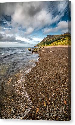 Nant Gwrtheyrn Shore Canvas Print by Adrian Evans