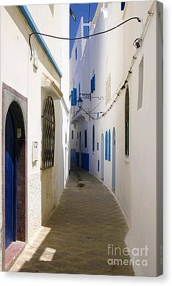 Canvas Print featuring the photograph Narrow Backstreet In The Medina Of Asilah On Northwest Tip Of Atlantic Coast Of Morocco by Ralph A  Ledergerber-Photography