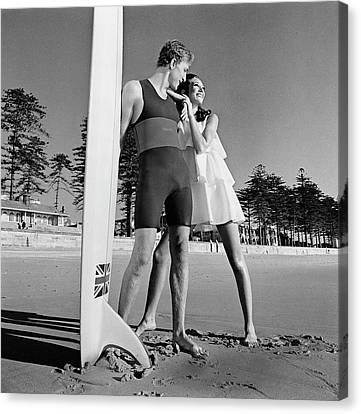 Nat Young And Marisa Berenson By A Surfboard Canvas Print
