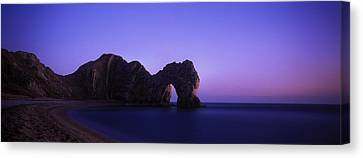 Natural Arch On The Beach, Durdle Door Canvas Print by Panoramic Images