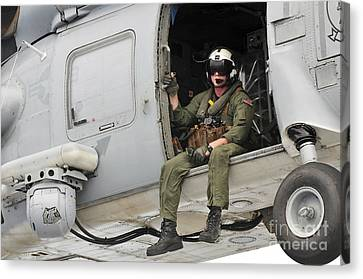 Naval Aircrewman Acts In An Sh-60b Sea Canvas Print by Stocktrek Images