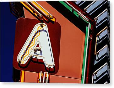 Canvas Print featuring the photograph Neon A - Aztec Theater by Daniel Woodrum