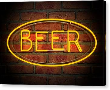 Neon Beer Sign On A Face Brick Wall Canvas Print