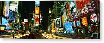 Neon Boards In A City Lit Up At Night Canvas Print by Panoramic Images