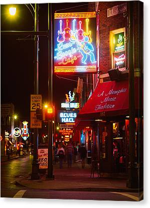 Neon Sign Lit Up At Night In A City Canvas Print by Panoramic Images