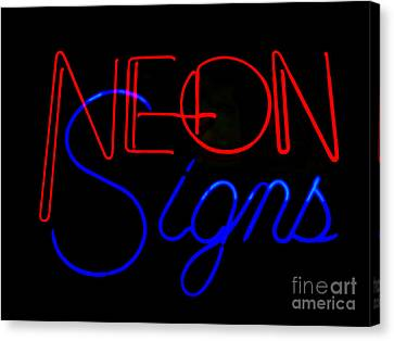 Neon Signs In Black Canvas Print by Kelly Awad