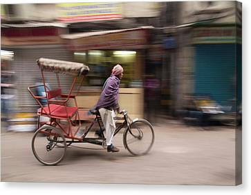 New Delhi, Pedicab, Rickshaw Speeds Canvas Print by Emily Wilson