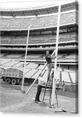New York Jets Football Crew Works On Field Goal Repairs Canvas Print by Retro Images Archive