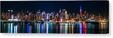 Canvas Print featuring the photograph New York Panorama By Night by Mihai Andritoiu