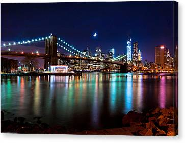 Canvas Print featuring the photograph New York Skyline And Brooklyn Bridge With Crescent Moon Rising by Mitchell R Grosky