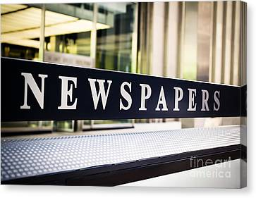 Newspapers Stand Sign In Chicago Canvas Print by Paul Velgos